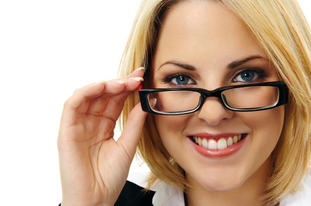 Close-up portrait of a beautiful young woman with spectacles  Stock Photo - 7542182
