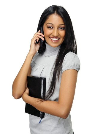 Cute Indian girl talks on her mobile phone photo