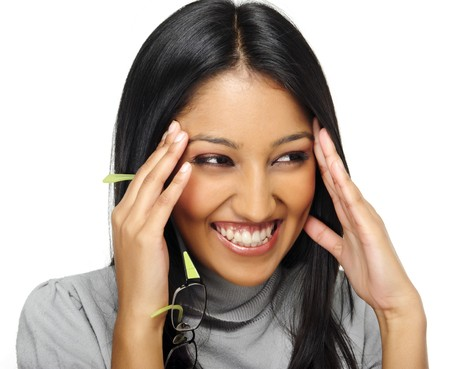 people laughing: Cute Indian girl laughs and touches her face Stock Photo