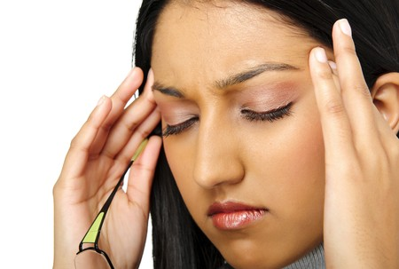 Indian beauty has a headache caused by stress photo