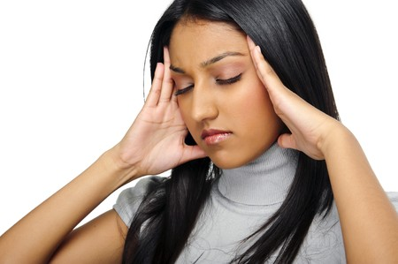 Indian beauty has a headache caused by stress Stock Photo - 7786171