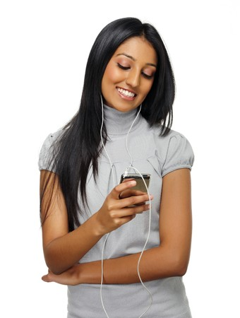 Indian girl listens to her music on her mp3 player Stock Photo - 7786146