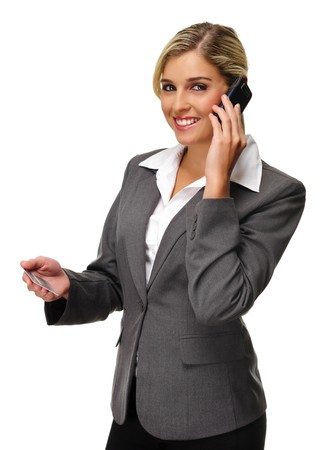banker: Attractive woman holds credit card and talks on phone Stock Photo