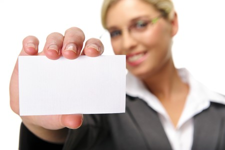 Blonde businesswoman shows her card to the camera, selective focus on business card. Banque d'images - 7786104