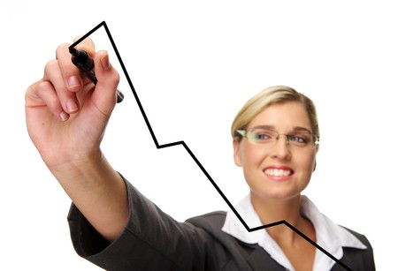 executive assistants: Blonde businesswoman draws business charts Stock Photo