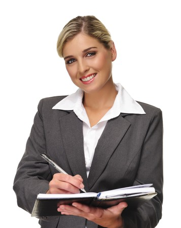 Young blonde business woman writes in her personal planner Stock Photo - 7786106
