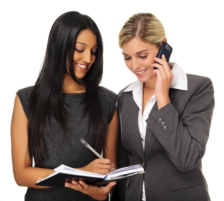 Attractive businesswomen planning their meeting with organiser and phone Stock Photo - 7786164
