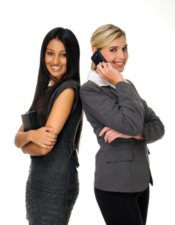 woman posing: Confident young businesswomen stand together and look towards camera