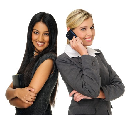 Confident young businesswomen stand together and look towards camera photo