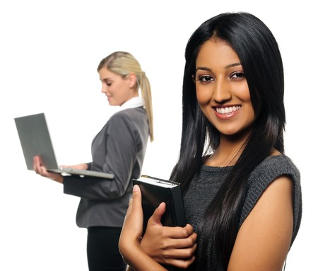 Confident young business woman with co-worker in background photo