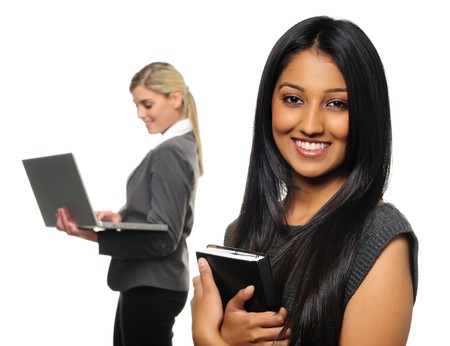 Confident young business woman with co-worker in background Stock Photo - 7786124