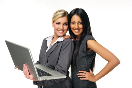 Sexy young businesswomen pose with laptop photo