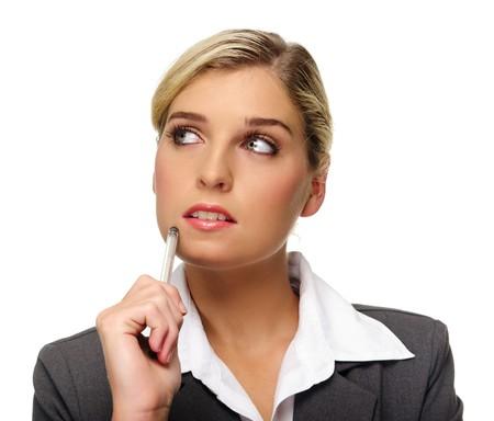 Business woman looks upward and thinks photo