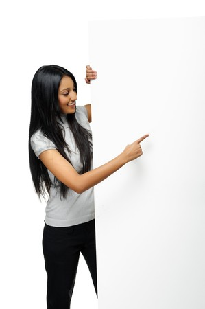 Cute Indian woman presents with a blank white board photo