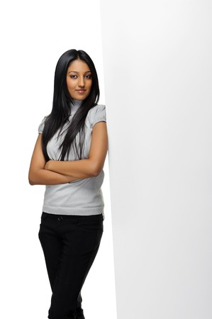 Cute Indian woman presents with a blank white board Stock Photo - 7786060