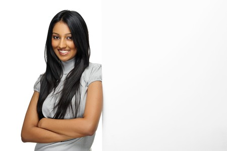 Cute Indian woman presents with a blank white board Stock Photo - 7786109