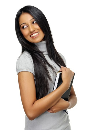 Casual Indian woman holds diary and smiles Stock Photo - 7786130