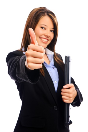 Businesswoman holding a laptop showing a thumbs up sign, selective focus on hand photo