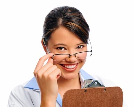 Femeninas sonrisas profesionales m�dicos en estudio, aislados en blanco Foto de archivo - 8727180