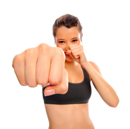 punch: Attractive young woman boxing as a form of exercise, selective focus on fist, isolated on white Stock Photo