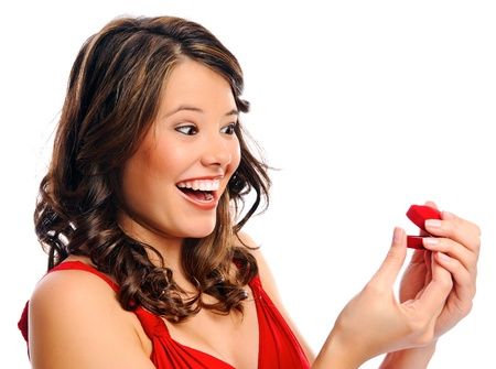 Beautiful young woman receives a red heart gift box, isolated on white Stock Photo - 8727054