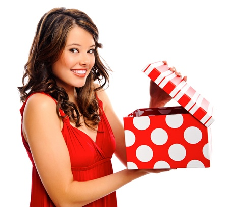 Attractive young woman opens the present she received Stock Photo - 8727207