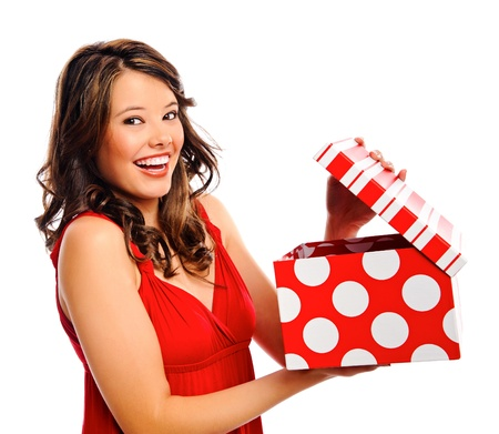received: Attractive young woman opens the present she received
