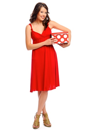 Attractive young woman is happy to receive a present photo