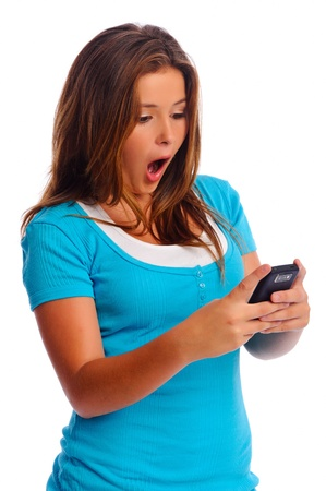 gasp: Teenager is shocked as she reads a text message on her cell phone