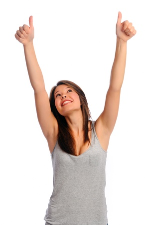 signify: Isolated beautiful girl has her arms raised and thumbs up to signify a job well done