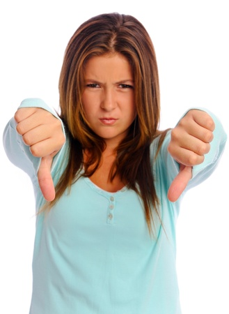 Young isolated teenager points her thumbs down to express disapproval Stock Photo - 8726193