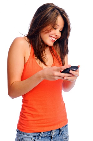 Attractive young brunette woman using her cell phone to send a text message Stock Photo - 8727044
