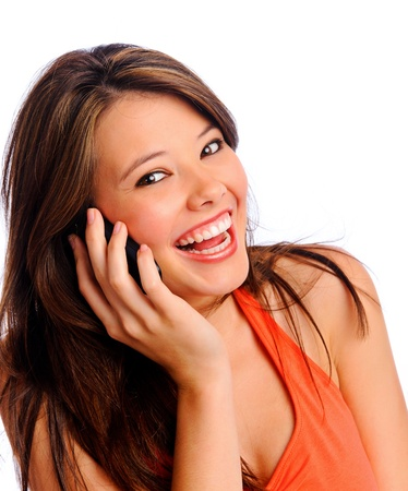 talking telephone: Happy, smiling, fun brunette girl using cell phone and looking at camera