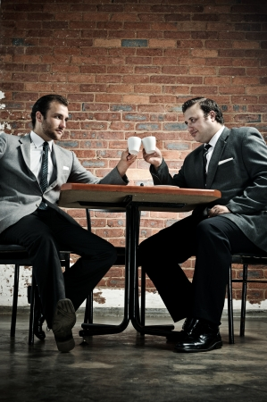 Business deal in a cafe, agreed with cappucinos  photo