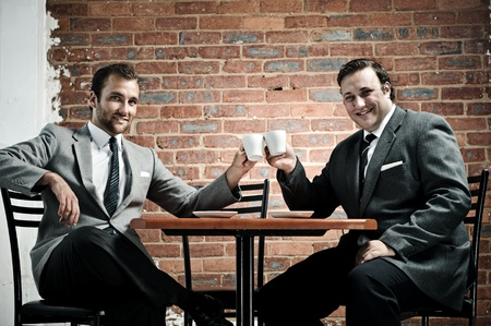 deal in: Business deal in a cafe, agreed with cappucinos  Stock Photo