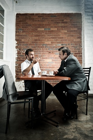 discuss: Coffee date debate between two men during their lunch break Stock Photo