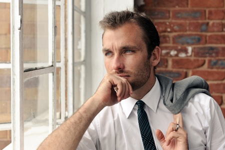 Man looks out the window thoughfully, nice portrait of a businessman Stock Photo - 8726701