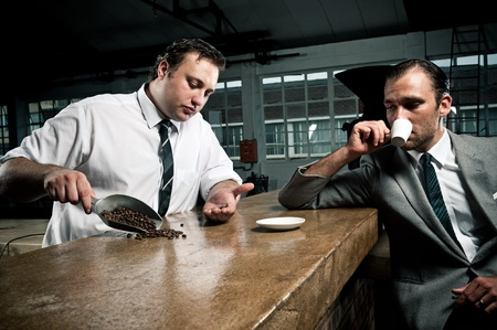conversations about coffee between barista and businessman photo