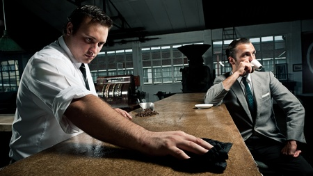 Vintage style, 70's barista and businessman in and industrial style cafe Stock Photo - 8726770