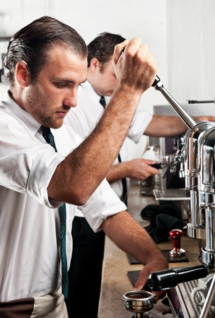 professional expert barista makes coffee with a machine Stock Photo - 8726643