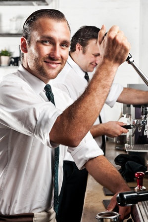 professional expert barista makes coffee with a machine  photo