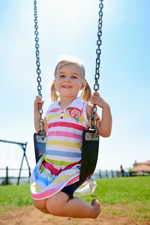 Young child on swing in playground outdoors Stock Photo - 8726940