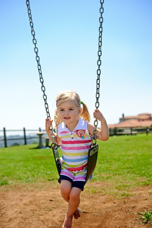 Young child on swing in playground outdoors Stock Photo - 8726945