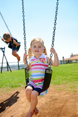 Young child on swing in playground outdoors Stock Photo - 8726901