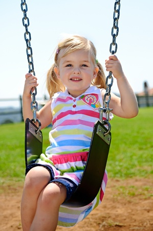 Young child on swing in playground outdoors Stock Photo - 8726868