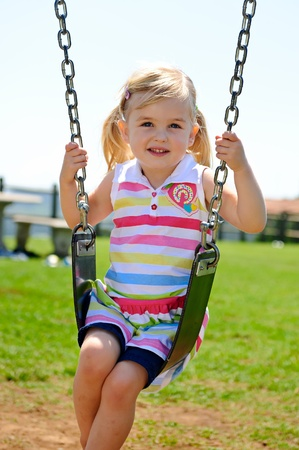 Young child on swing in playground outdoors Stock Photo - 8726949