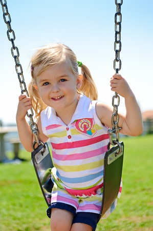 Young child on swing in playground outdoors Stock Photo - 8726906