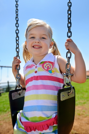Young child on swing in playground outdoors Stock Photo - 8726862