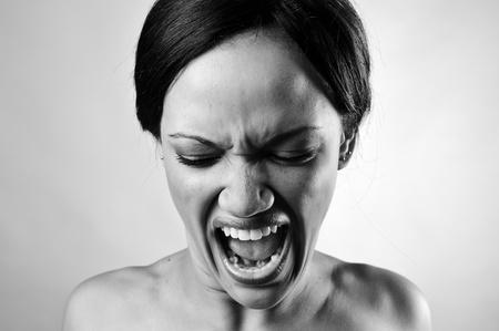 Amazing screaming fashion model isolated and monochrome photo