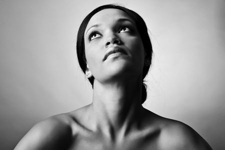 Monochrome fashion model portrait isoladed in studio photo